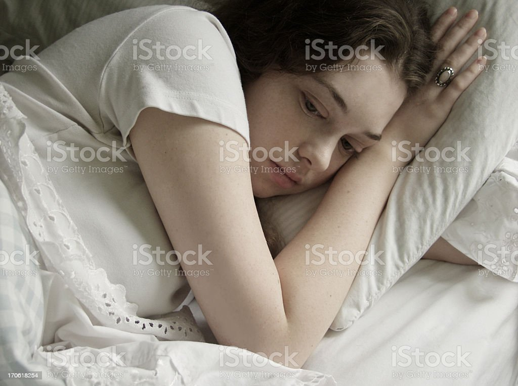 thinking in bed stock photo