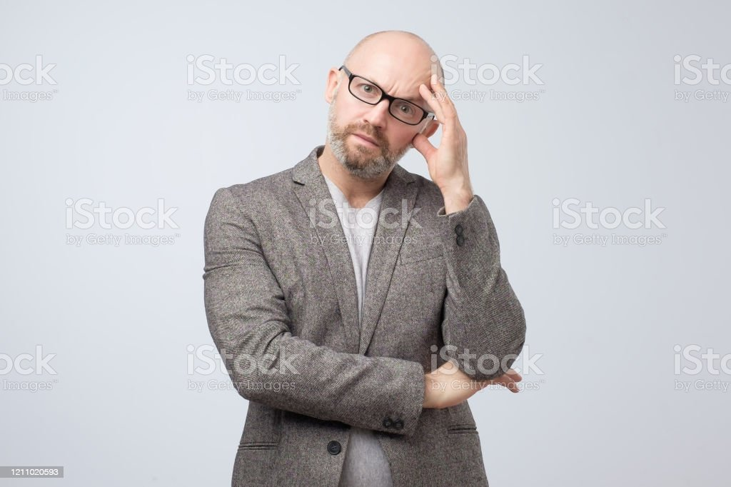 Thinking Man In Glasses Scratching His Head Being Confused Stock Photo - Download Image Now - iStock