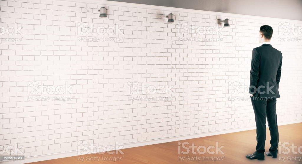 Thinking man looking at wall royaltyfri bildbanksbilder
