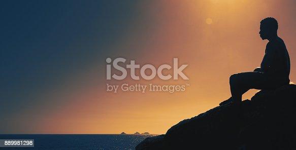 888342518 istock photo Thinking man on hill at sunset 889981298