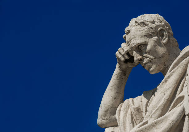 Thinking Man statue (with copy space) Man statue in the act of thinking against blue sky. Ancient Roman Julian the Jurist statue erected at the end of 19th century in front of the Old Palace of Justice in Rome jurist stock pictures, royalty-free photos & images