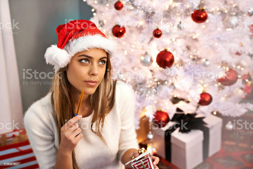 Thinking of the perfect Christmas message stock photo