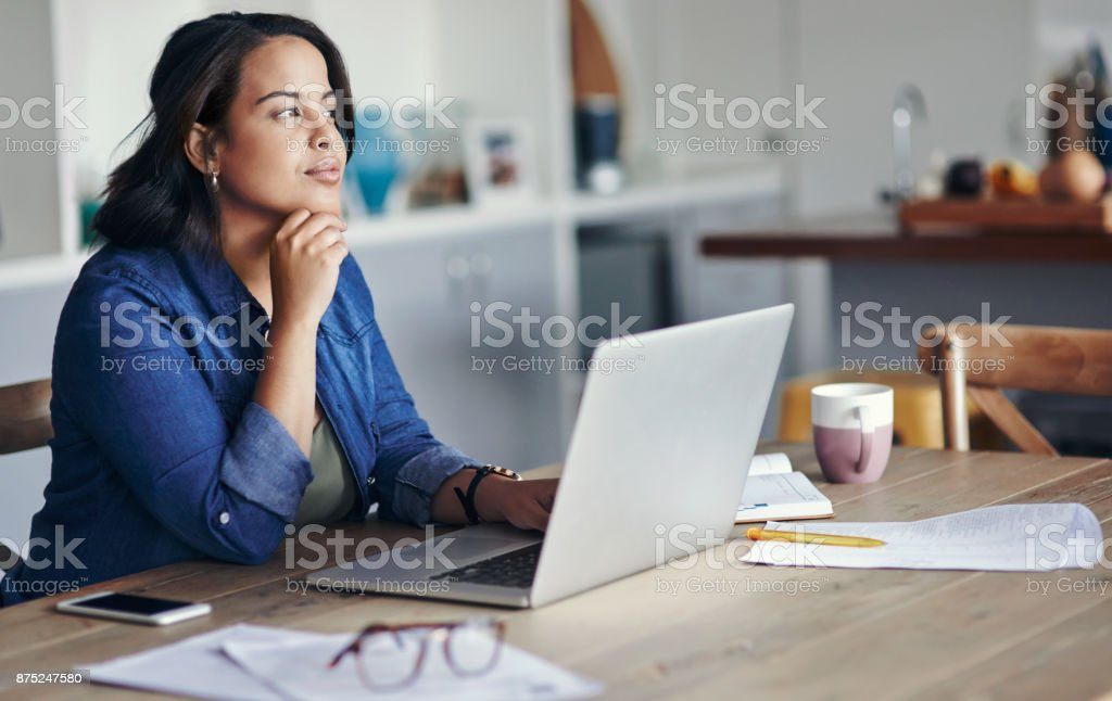 Thinking of ways to expand her home business stock photo
