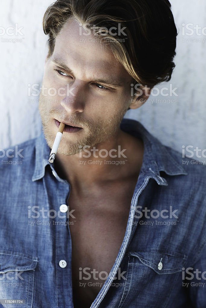 Thinking over a cigarette royalty-free stock photo