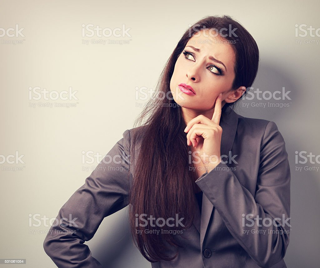 Thinking unhappy business woman in suit looking. Closeup toned stock photo