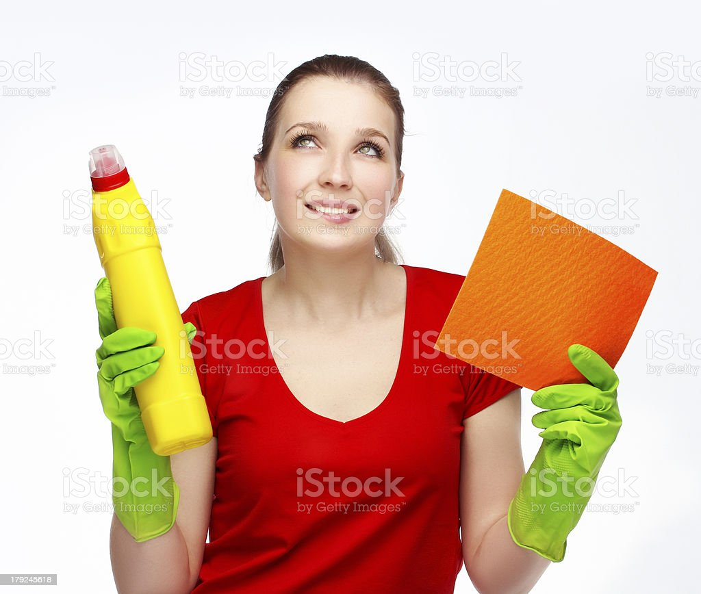 Thinking woman  holding cleaning supplies royalty-free stock photo