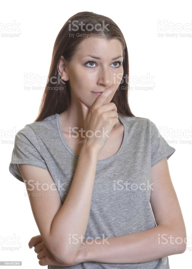 Thinking woman with brunette hair royalty-free stock photo