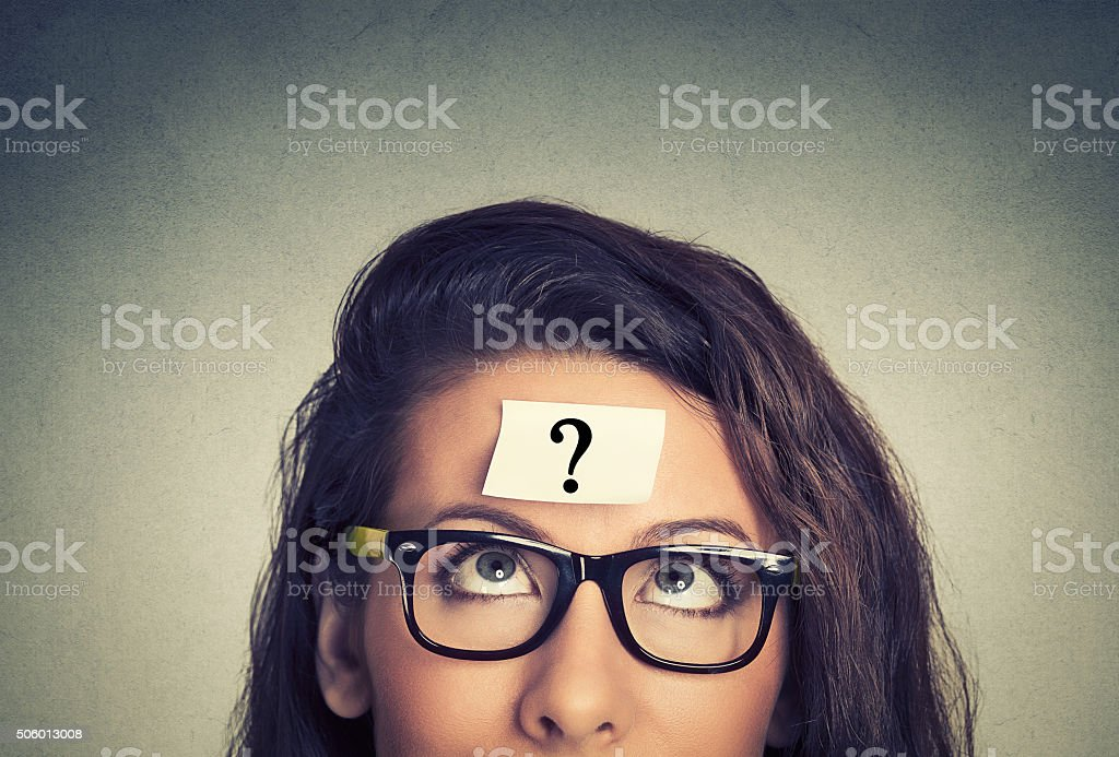 thinking woman with question mark stock photo