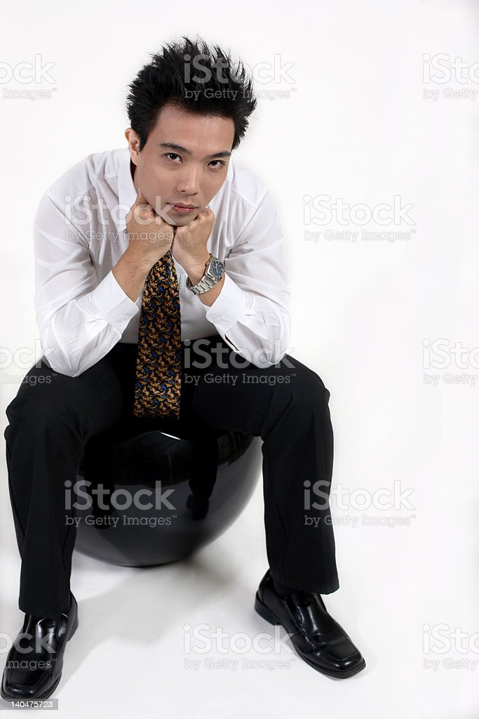 thinking young businessman stock photo