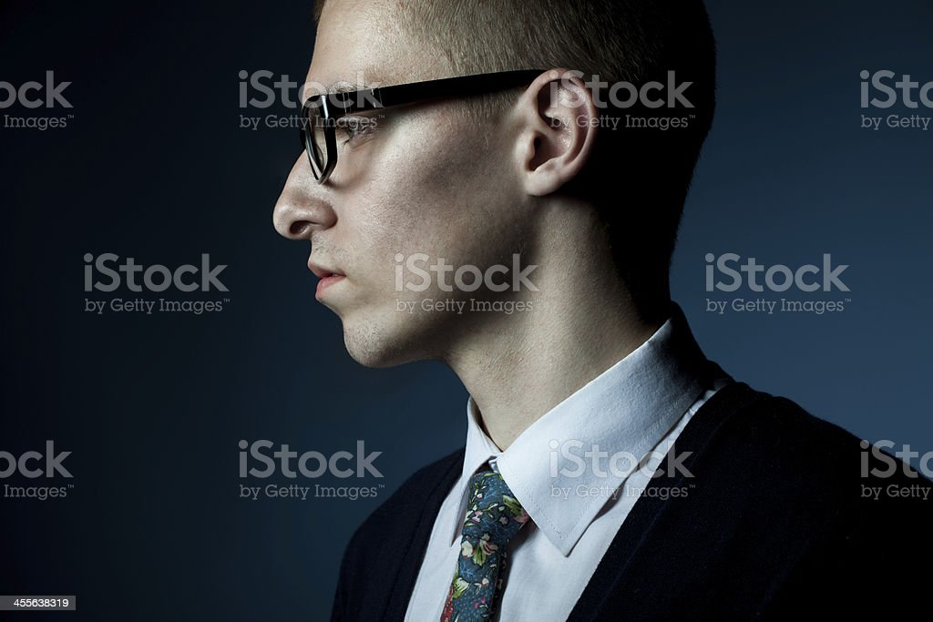 thinking young man profile portrait stock photo