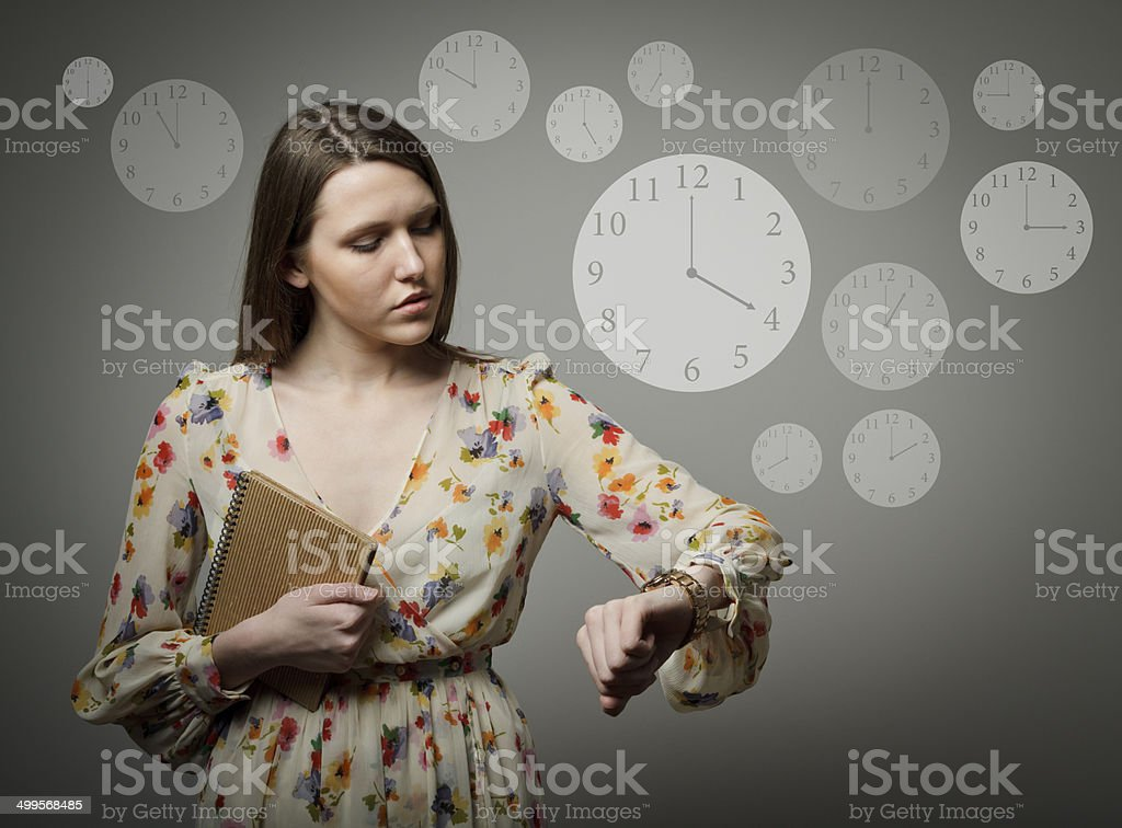 Thinking. Young woman and wristwatch. 4 p.m. stock photo