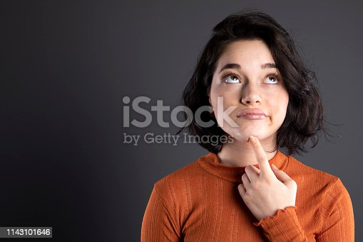 618976144 istock photo Thinking young woman 1143101646
