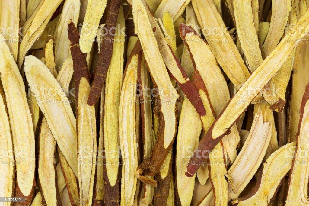 Thinly sliced licorice root (Liquorice) used as herbal medicine (Glycyrrhiza glabra) stock photo