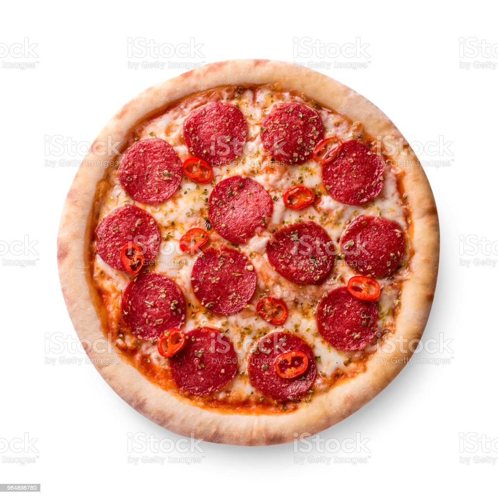 Thinly sliced pepperoni is a popular pizza topping in American-style pizzerias royalty-free stock photo