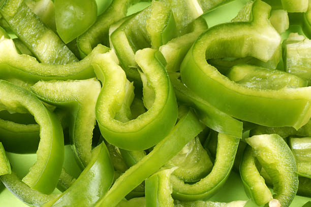 Thinly sliced up green bell peppers stock photo