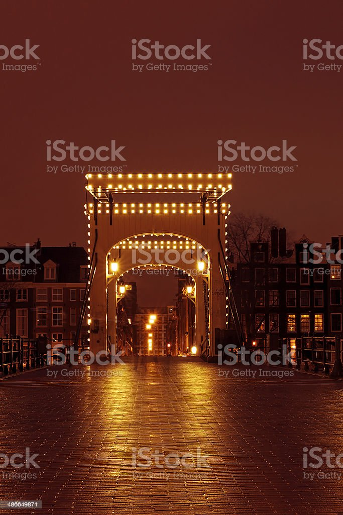 Thiny bridge in Amsterdam Netherlands by night stock photo