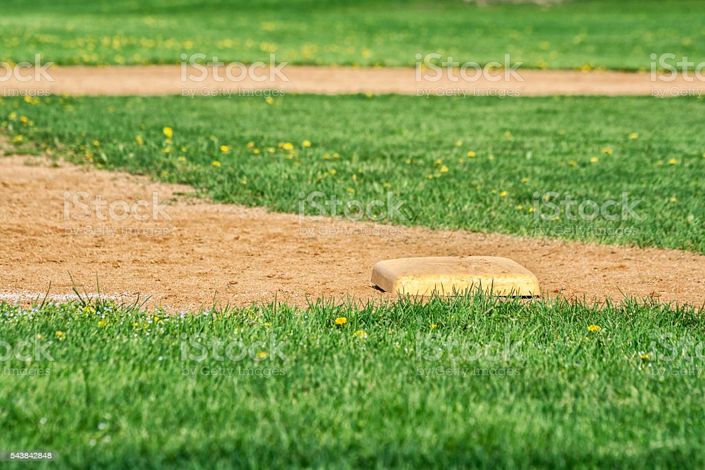 Third Base On High School Baseball Diamond Playing Field stock photo