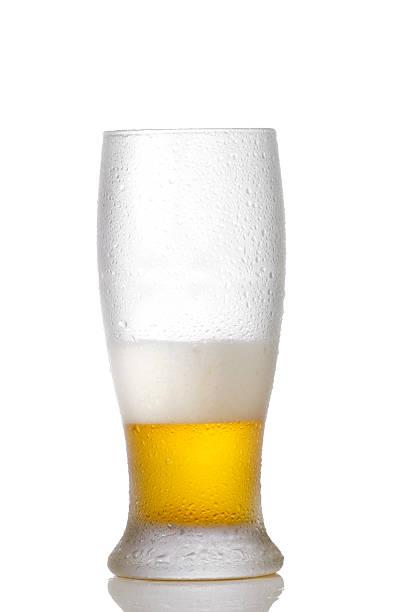 Third full  beer glass stock photo