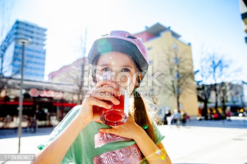 Thirsty Little Girl a enjoying Strawberry Juice