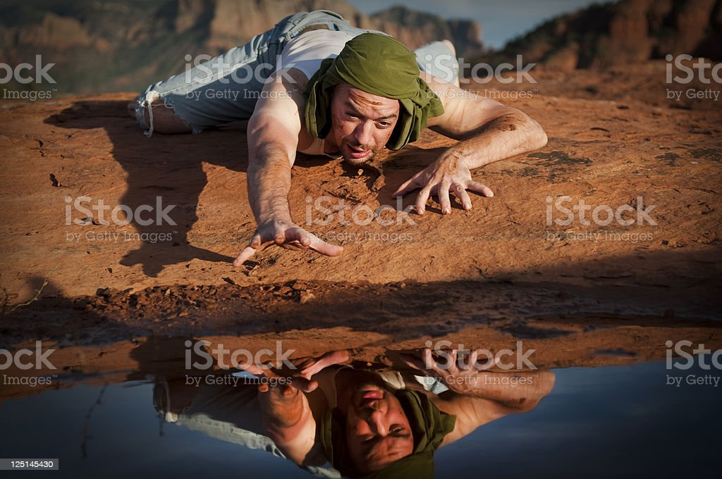 Thirsty Man in the Desert stock photo