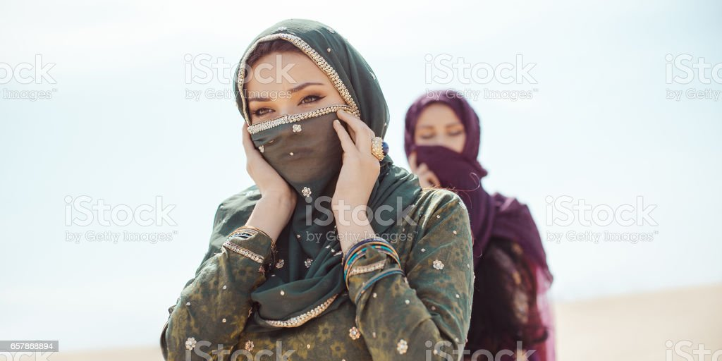 Thirsty women walking in a desert. Lost during the travel stock photo