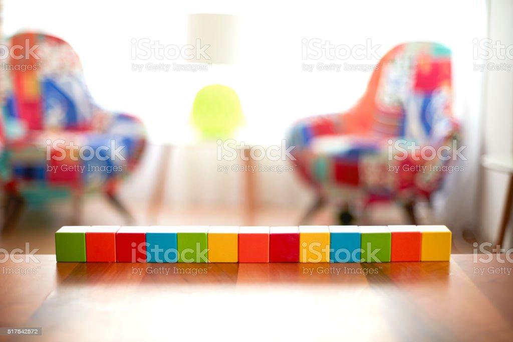 Thirteen Blank building blocks on wooden table stock photo