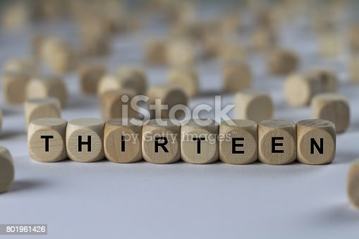 istock thirteen - cube with letters, sign with wooden cubes 801961426