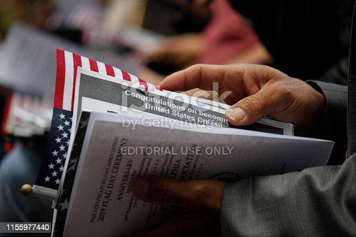 Philadelphia, PA, USA - June 14, 2019: Thirteen immigrants from 12 different countries become new U.S. citizens in a special naturalization ceremony on Flag Day at the historic Betsy Ross House in Philadelphia, Pennsylvania.