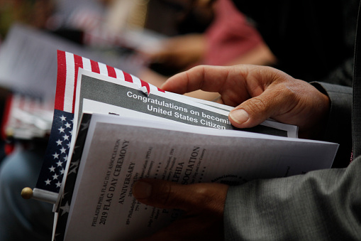 Philadelphia, PA, USA - June 14, 2019: Thirteen immigrants from 12 different countries become new U.S. citizens in a special naturalization ceremony on Flag Day at the historic Betsy Ross House in Philadelphia, Pennsylvania.\