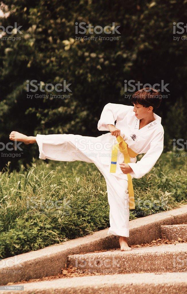 Thirteen year old Tae-Kwon-Do yellow belt boy royalty-free stock photo