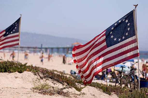 Thirteen-star American flags, fly at the beach stock photo