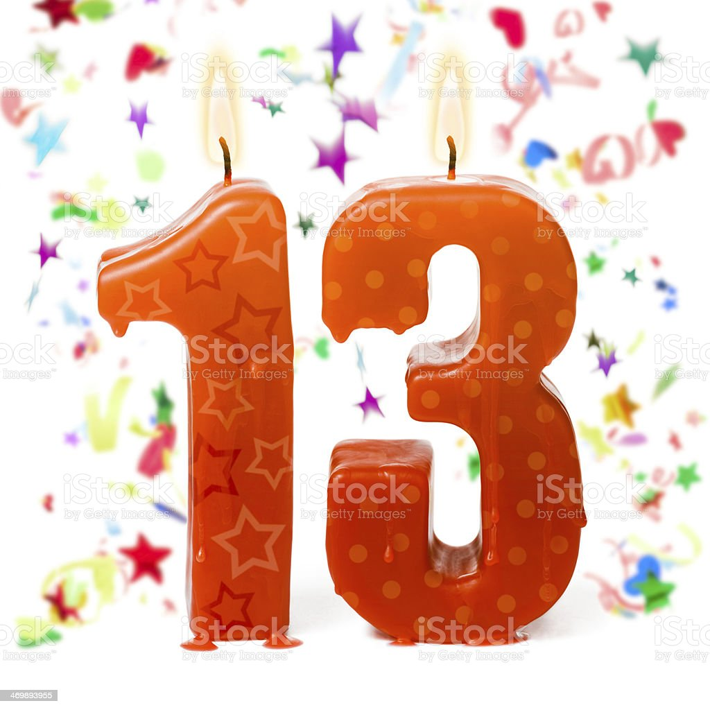 Thirteenth birthday candles and confetti stock photo