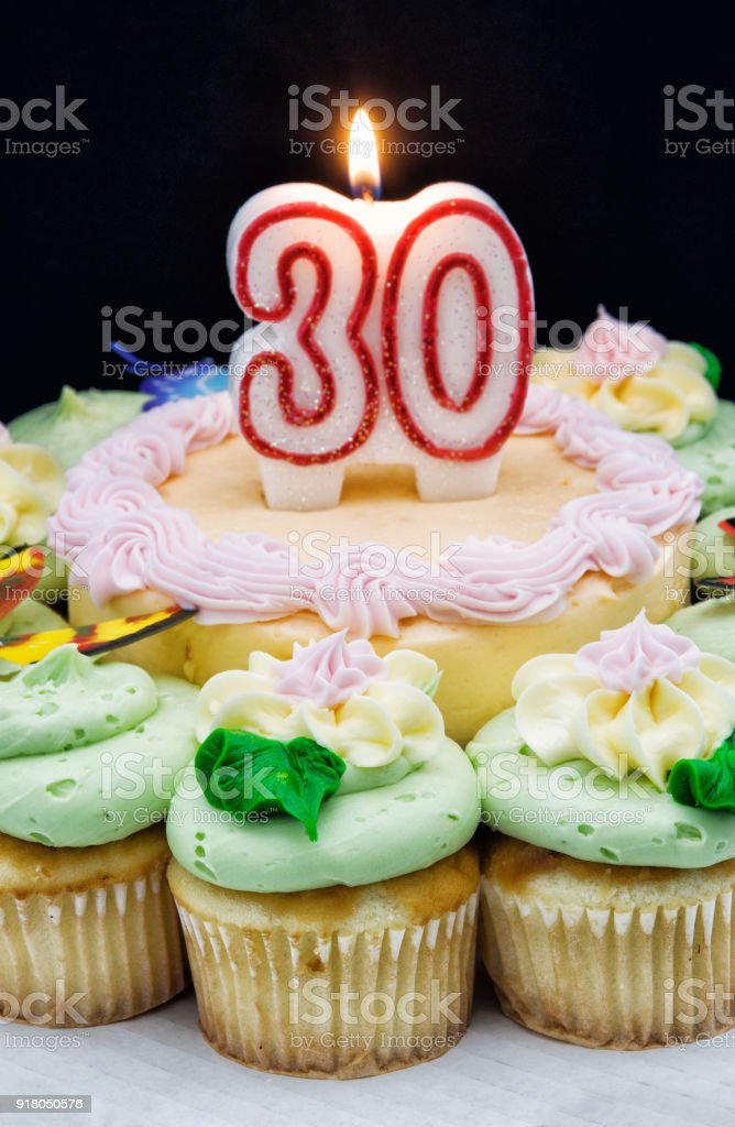 Thirty Candle Burning On A Birthday Cake Stock Photo More Pictures