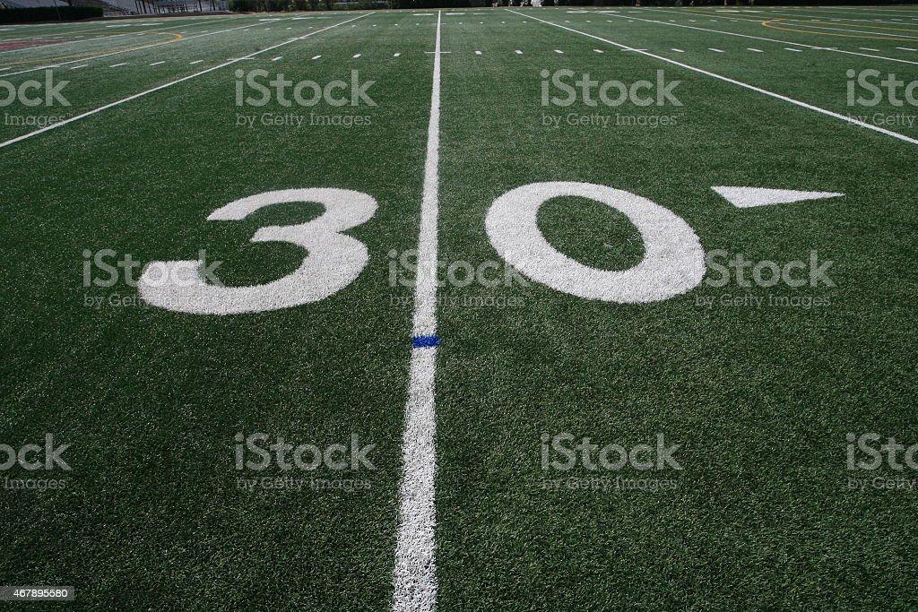 Thirty yard line on an American football field.