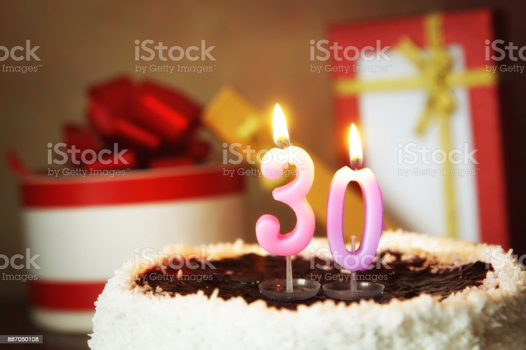 Thirty Years Birthday Cake With Burning Candles And Gifts Stock