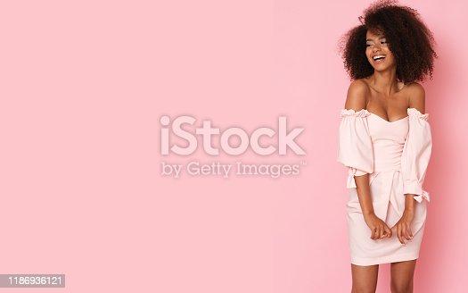 Beautiful lady in pink mini dress.