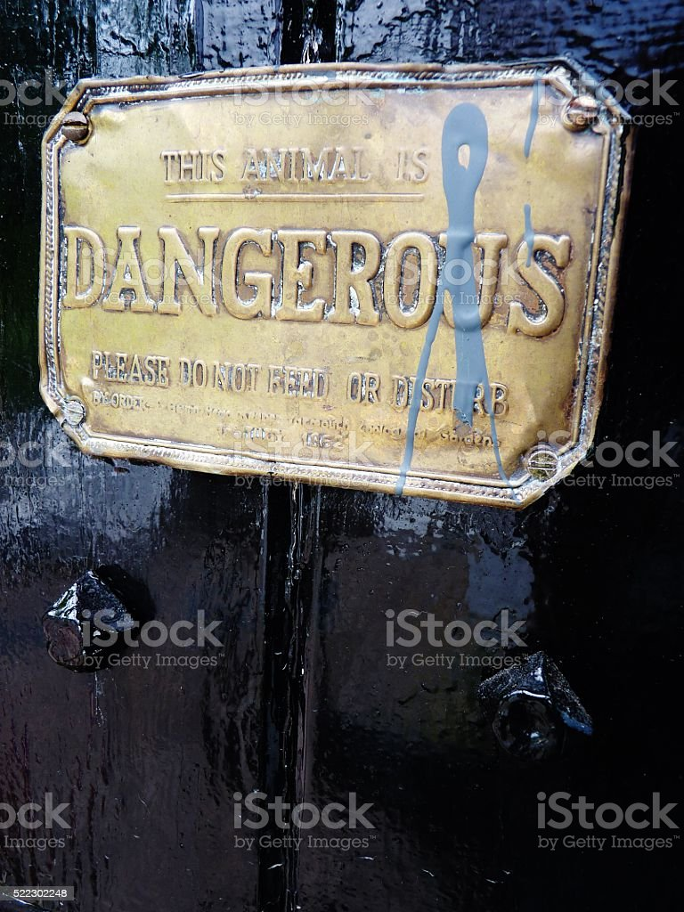 this animal is dangerous sign stock photo