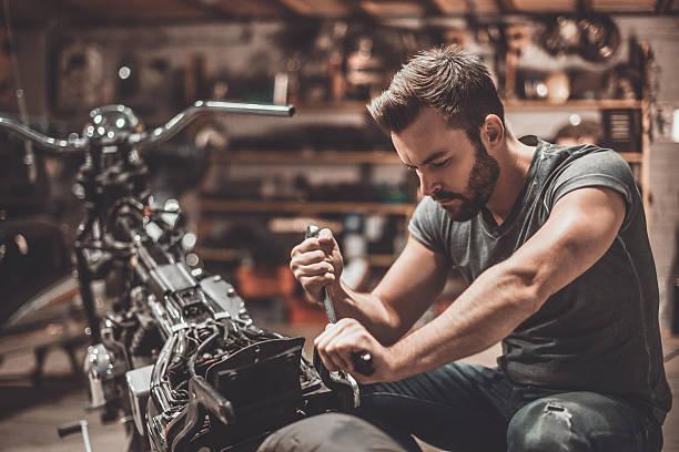 this bike should be perfect. - motorrad männer stock-fotos und bilder