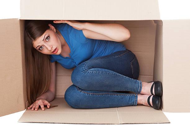 this box is too small. - claustrofobie stockfoto's en -beelden