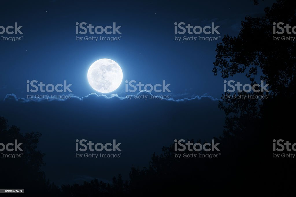 This Bright Shining Super Moon Iluminates The Night TIme Sky royalty-free stock photo