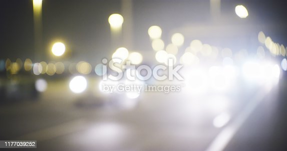 Cropped shot of a busy highway that is brightly lit with street lamps and headlights during the night