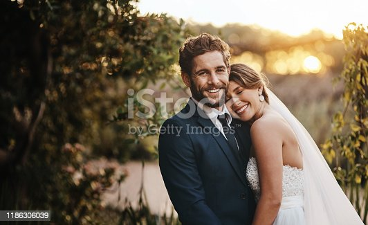 Shot of a happy young couple standing together on their wedding day