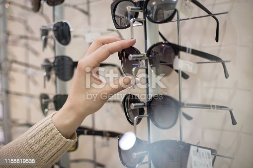 This for sun. Woman taking glasses.