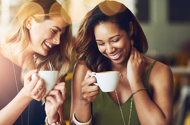 This friendship runs on coffee, love and laughter stock photo