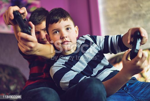 Two Boys Playing Games, Teenage boys at home , joystick in hands. Gaming game play video on tv or monitor. Gamer concept