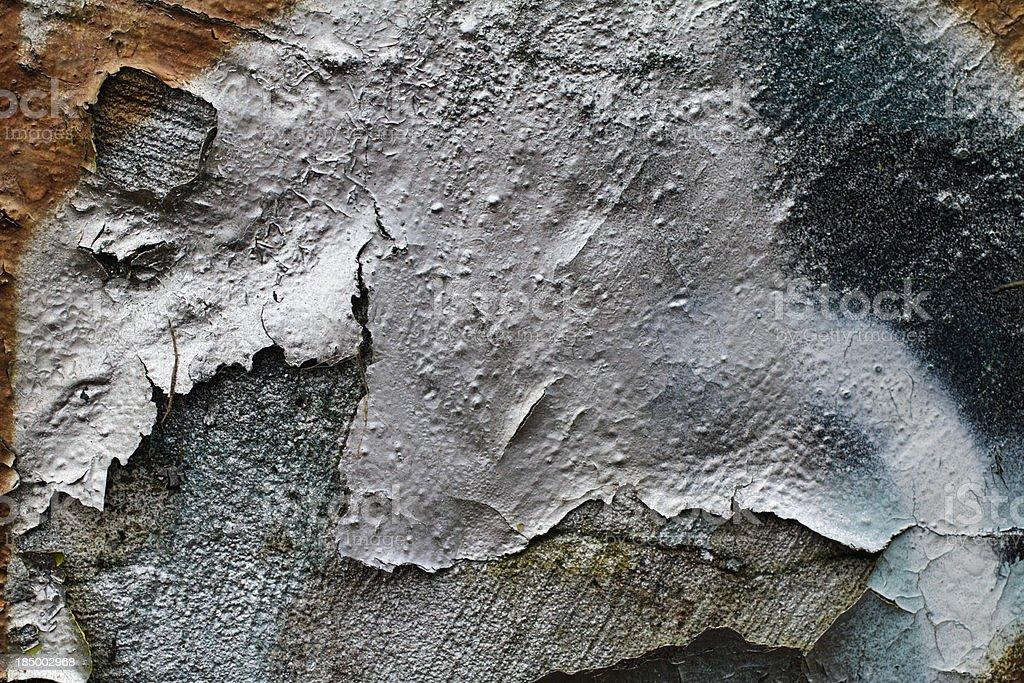 Peeling paint sprayed graffiti silver on plastered wall texture stock photo