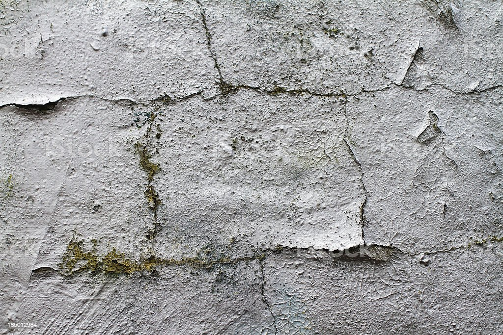Grunge ageing sprayed graffiti silver on plastered wall texture stock photo