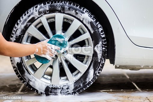 istock This image is a picture of wiping the car with a blue microfiber cloth by hands.Car wash concept. 1074106336