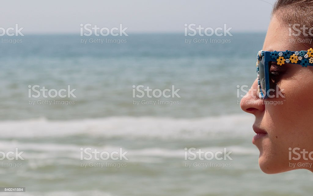 Profile beautiful young Russian woman outdoor girl soft sea background stock photo