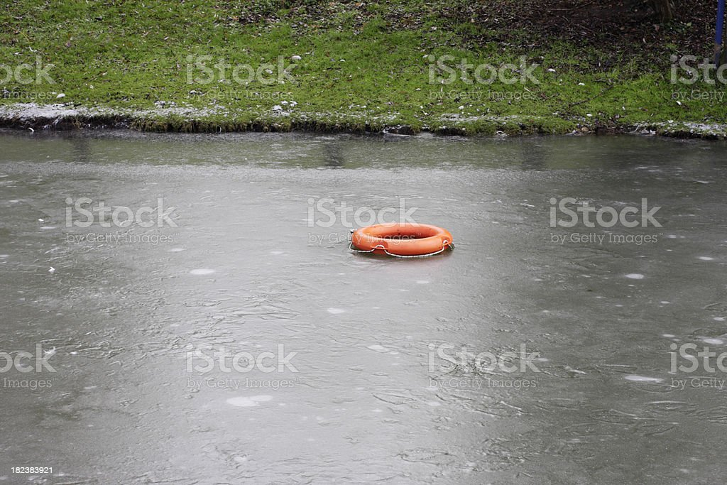 Lifebelt cast upon icy surface of Wilts and Berks Canal stock photo
